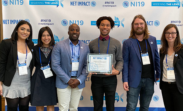 Net Impact members with their certificate as finalist for the 2019 Graduate Chapter of the Year